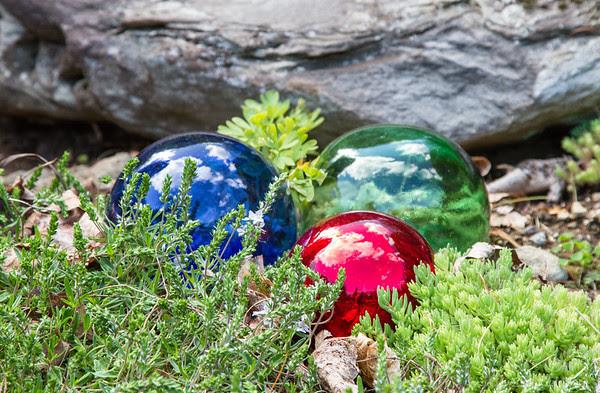 globes of bright glass, hidden