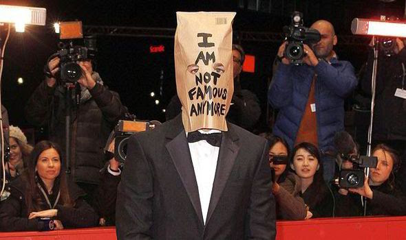 A part of me thinks that Shia LaBeouf  is a whore for attention.. the other part of me thinks his behavior has gone beyond the 'act' and is becoming real..  Nonetheless, his latest stint in the public eye involves his arrest at the Broadway musical Cabaret last night..  According to witnesses, reports, and all that: He was smoking and being very loud and disruptive..   Read some more here.. And yes, this may not be the most important event in the news today, but it's interesting to me. Either we are watching a new modern version of Andy Kauffman in action, or we are seeing the default behavior of a flailing and failing celebrity.  Act or not, the Shia has fallen.