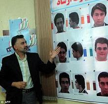 Fashion rules: An Iranian official shows pictures of hairstyles authorised by the Ministry of Guidance at an official hairdressing show in the capital Tehran