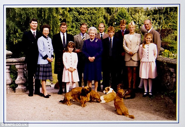 Brave face: A show of unity for the Royals - with Diana and Sarah Ferguson notable by their absence - in a 1998 festive missive. Diana had died the year before in 1997, while Fergie and Andrew separated in 1996