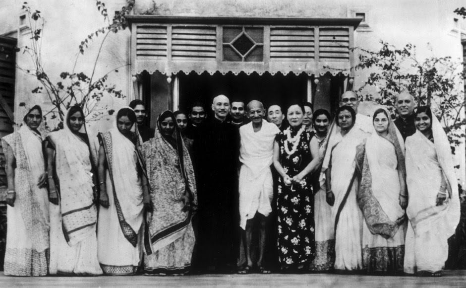 <p> Premier of the Republic of China Chiang Kai-shek (1887-1975) with his wife, Soong May-ling (1898-2003), stand either side of Mahatma Gandhi after a meeting between Chiang Kai-shek and Gandhi to discuss matters of common concern to both India and China, in India, circa 1930. Getty Images</p>