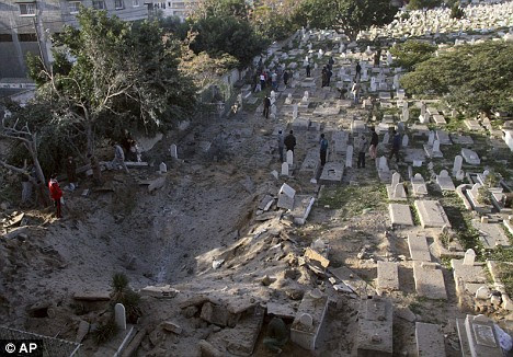 The crater left after Israeli forces bombed a cemetery in Gaza today, sending body parts flying onto neighbouring houses