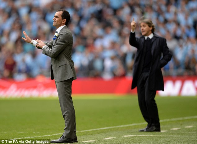 Decisions: Both managers issue instructions to their team during the match