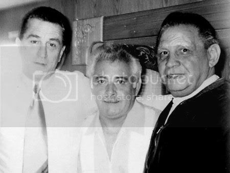Robert De Niro(c) poses inside his trailer with the late mob boss Anthony 'Fat Andy' Ruggiano (r) for research on his role.
