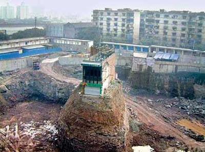 House left standing in the midst of multi-floor excavation