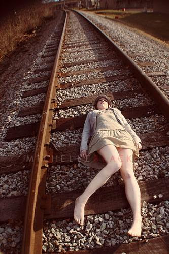 Woman on tracks