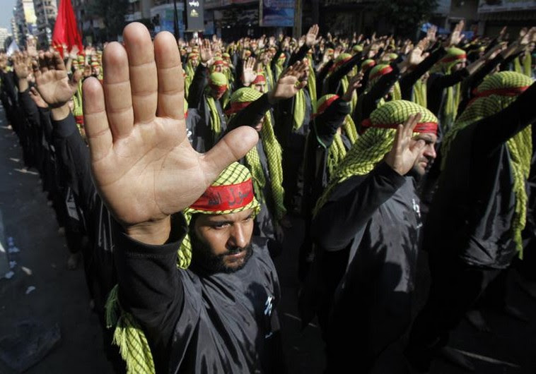 Lebanese Hezbollah supporters gesture as they march during a religious procession to mark Ashura