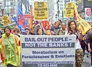 April 3, 2009 demonstration on Wall Street calling for a complete bailout of the people, not the banks. The demonstration was organized by the Bailout the People Movement (BOPM). by Pan-African News Wire File Photos