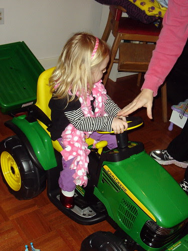 Riding her tractor