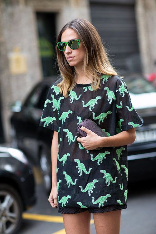 Le-Fashion-Blog-Street-Style-Dino-Print-Look-Milan-Fashion-Week-1 photo Le Fashion Blog Street Style Dino Print Look Milan Fashion Week Bright Green Tort Sunglasses Black and Green Dinosaur Sheer Top Small Box Clutch With Chain Lining Black Sporty Perforated Shorts 1.jpg