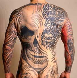 Grey Ink Skull And Tribal Tattoo On Back Body