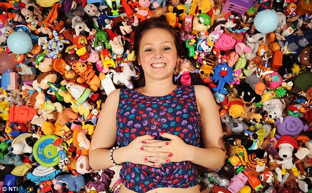 Headache: Miss Irvine struggles to find room for all the free toys she's got with meals