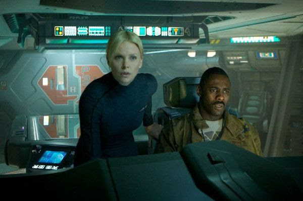 Meredith Vickers (Charlize Theron) and Janek (Idris Elba) on the bridge of Prometheus in PROMETHEUS.