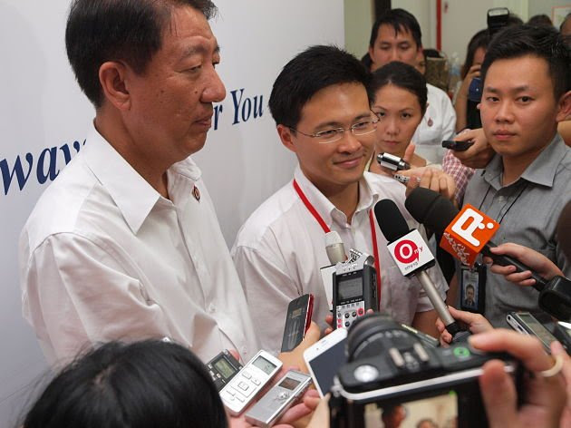 Desmond Choo speaks to reporters, along with Deputy Prime Minister Teo Chee Hean, after the by-election results were announced. (Yahoo! Singapore/ Alvin Ho)