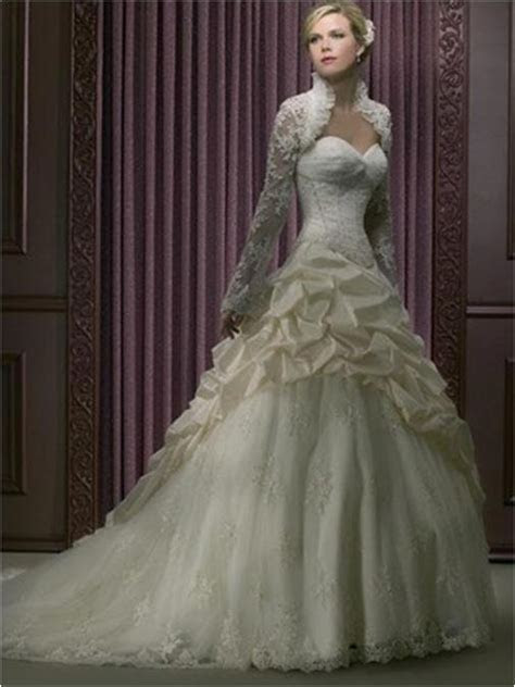 Wedding gown with long sleeve lace shrug.