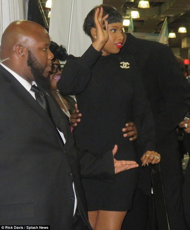 Beautiful in black: The Oscar winner showed off her enviable figure in a long-sleeved, skintight black mini dress