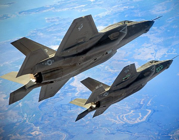 Two F-35B Lightning II fighter jets fly in formation above a test range near Naval Air Station Patuxent River in Maryland...on March 17, 2011.