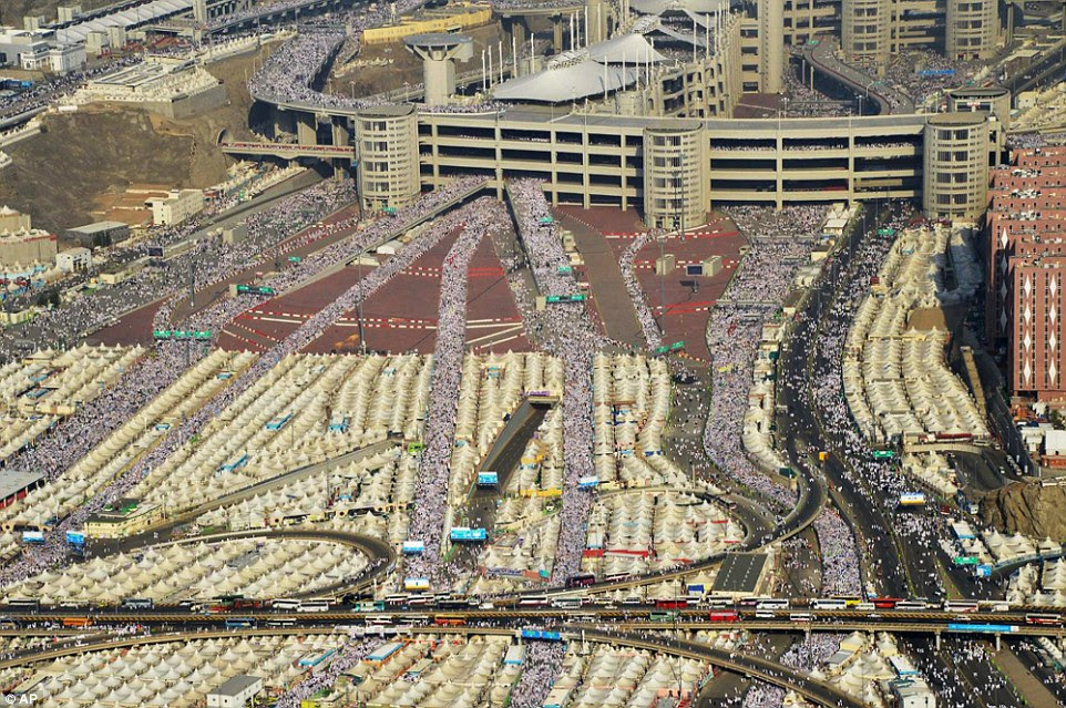 Hundreds of thousands of Muslim pilgrims make their way to cast stones at a pillar symbolising the stoning of Satan, in the last rite of the annual Hajj, on the first day of Eid al-Adha