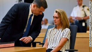 Defense attorney Joseph Cataldo talks to Michelle Carter in court.