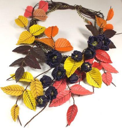 Погружение в Осень. Колье.. Колье.  Листья и цветы из натуральной кожи.  Серединки цветов - плавленый янтарь, лёгкие бусины.  Металл цвета бронзы.  Можно использовать как венок для фотосессий. Все веточки на проволочной основе, можно менять положение.