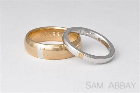 Yellow gold wedding band with platinum engagement ring