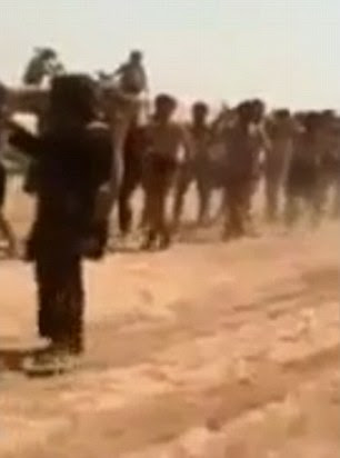 The captured men were escorted closely by Islamic State militants dressed in black and waving flags