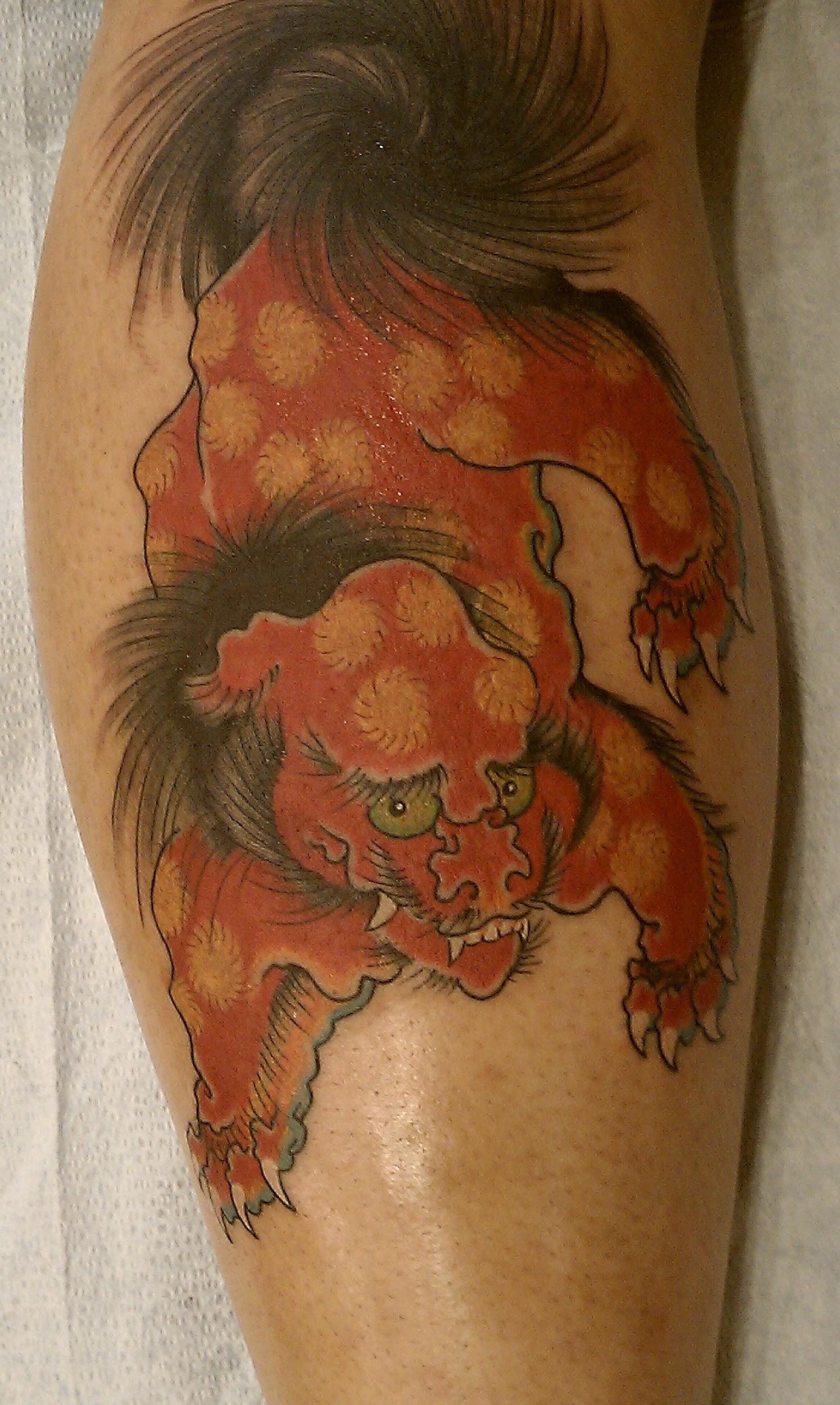 Here's a video of Daniel Herlihy filling in a Foo Dog tattoo.