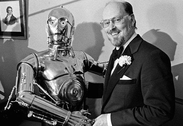 STAR WARS music composer John Williams poses with C-3PO.