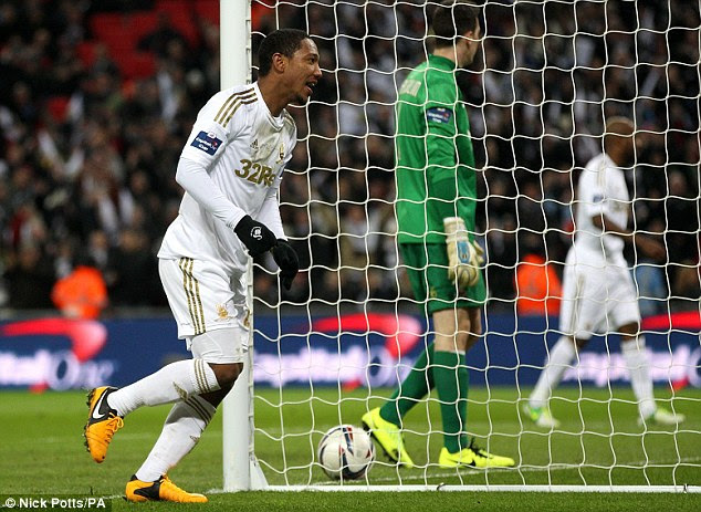 Final blow: De Guzman added a fifth goal in injury-time to complete a memorable afternoon for Swansea