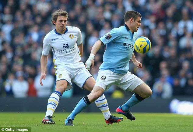 On the turn: James Milner tries to find a route past Leeds player Stephen Warnock