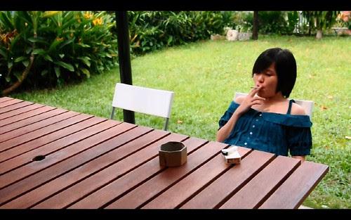 May (Jasminatha Teo) smoking in THAT DAY WE WOKE UP