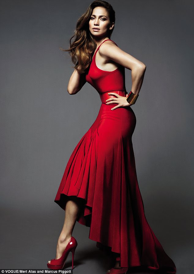 Ravishing in red! Jennifer Lopez shows off her shape in a waterfall scarlet dress and matching top as she poses in Vogue magazine