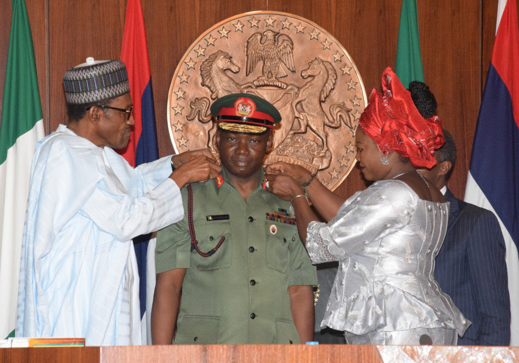 L-R; President Muhammadu Buhari; and Wife of the Chief of Defence Staff Mrs. Omobolanle Olonisakin Jointly decorating Chief of Defence Staff; General Abayomi Gabriel Olonisakin with his New Rank during the Decoration Ceremony of the new Service Chiefs at the Presidential Villa Abuja yesterday