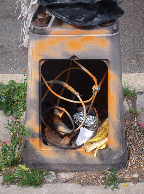 lamp base with exposed wire and garbage