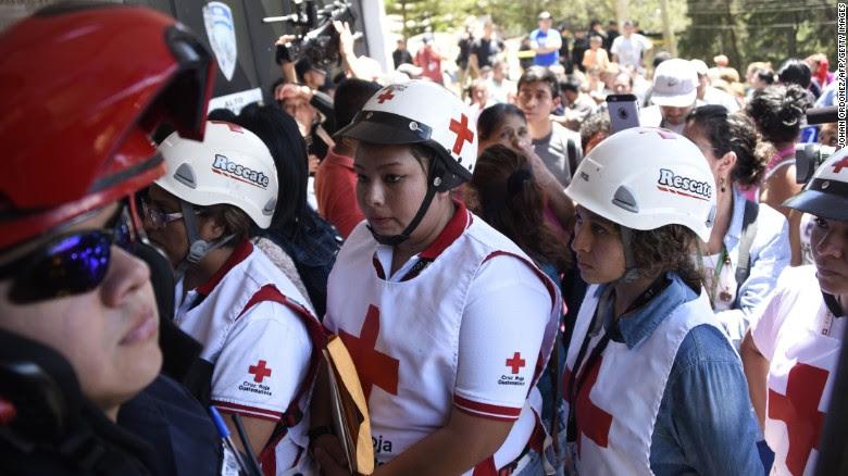 Guatemalan Red Cross members arrive at the Virgen de la Asunción Safe Home in San Jose Pinula.