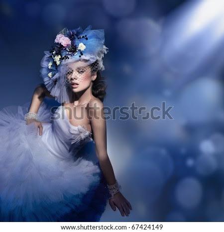 Beauty brunette in white dress - stock photo