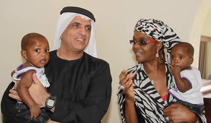 Ras Al Khaimah ruler Sheikh Saud Bin Saqr Al Qasimi with Republic of Zimbabwe First Lady Amai Grace Mugabe. The leader says that he is interested in investing in the Southern African state. by Pan-African News Wire File Photos
