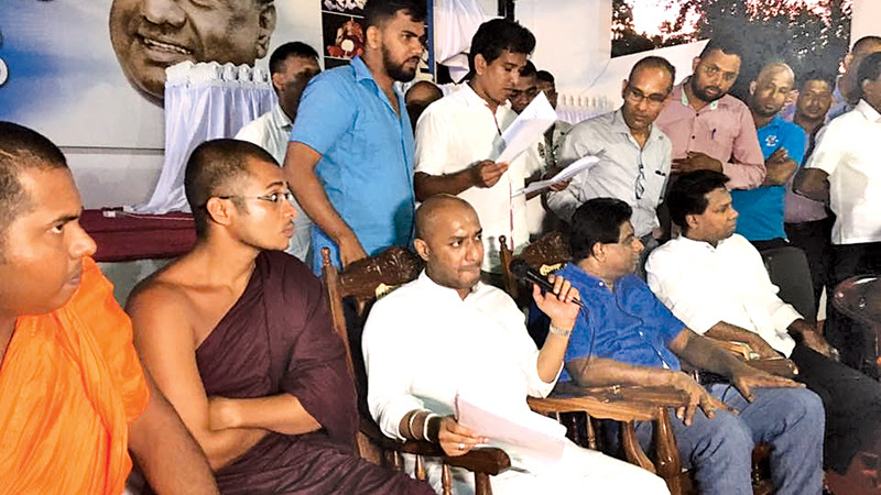 Agriculture Minister Duminda Dissanayake listening to the grievances of the NCP unemployed graduates at a recently held meeting on the issue. Picture by Nimal Wijesinghe