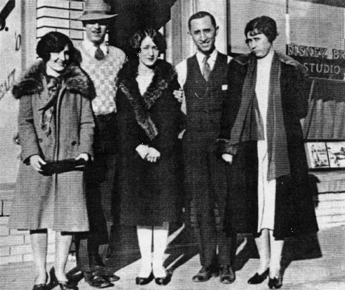 Walt and Roy O. Disney on the day that they opened the Disney studio. Beside them are their wives and mother.
