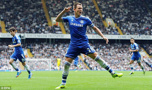 Leveller: John Terry celebrates after heading home the equalising goal to earn Chelsea a share of the spoils