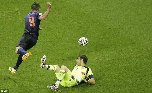 Calamitous error: Van Persie robs Iker Casillas to poke home Holland's fourth goal