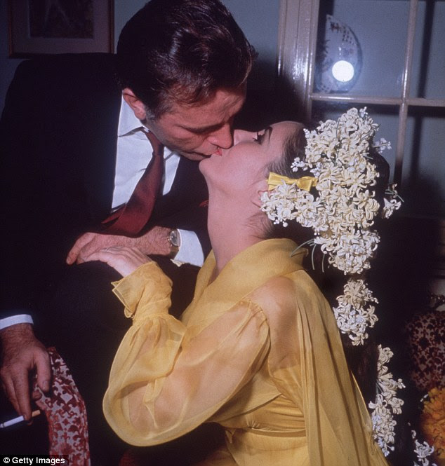 Elizabeth Taylor kisses Richard Burton on their first wedding day in 1964