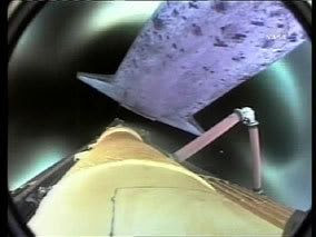 A camera onboard Discovery's external fuel tank captures this footage of the orbiter separating after main engine cut-off following launch.