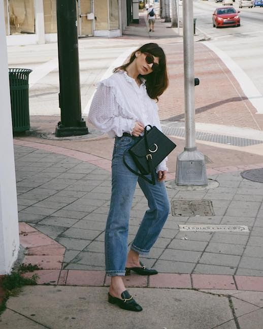 Le Fashion Blog Effortless Spring Outfit Sunglasses White Loose Blouse Black Shoulder Bag Vintage Jeans Black Loafers Via @saskaludilo