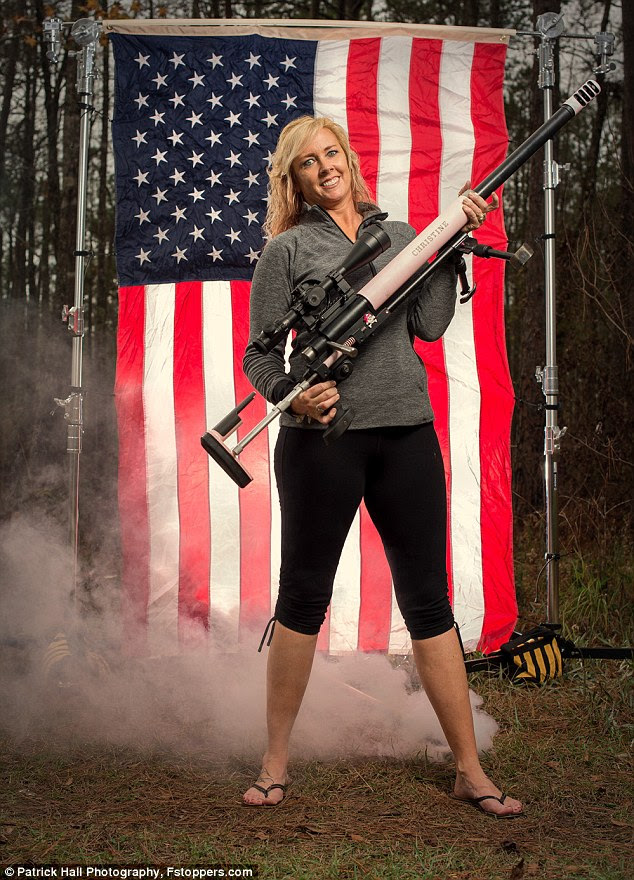 A woman called Christine poses with her custom-made, pink anti-tank rifle, bedazzled in shiny jewels at Twin Ponds Rifle Range in Awendaw, South Carolina