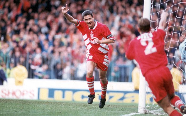 Famous finger: Liverpool and Wales goal machine Ian Rush gives his trademark post-goal salute