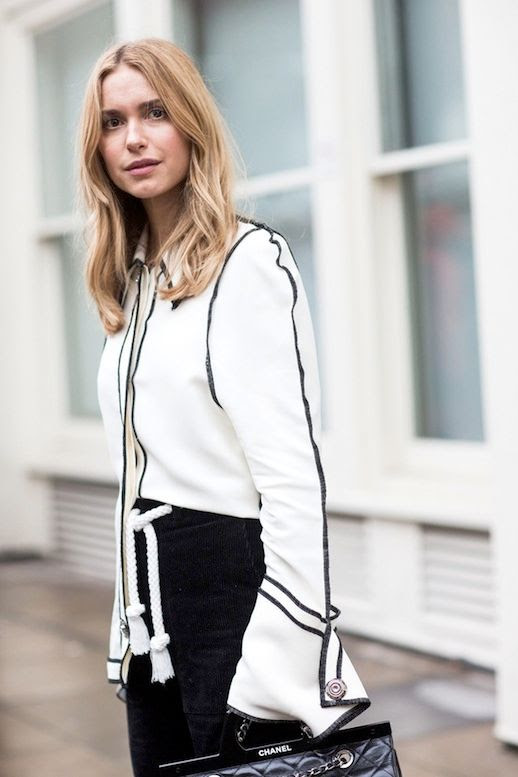 Le Fashion Blog Street Style Pernille Teisbaek Black And White Look Top With Contrast Piping And Flared Sleeves Pants Rope Belt Chanel Bag Via Vogue Paris