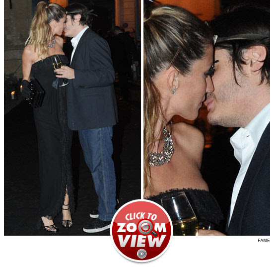 Gisele Bundchen kissing.