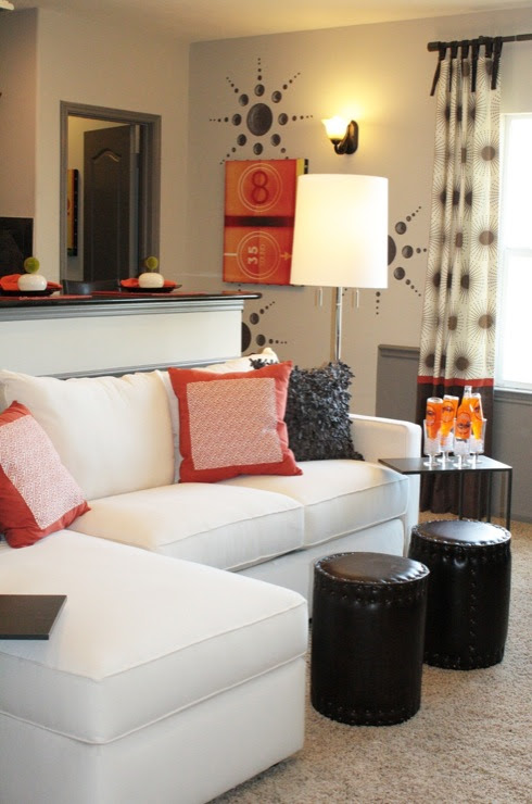 Suzie: Charm Home Design - Chic, modern orange & black living room design with white sectional ...