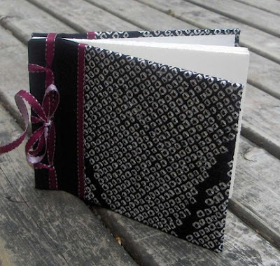 handmade photo album covered in Japanese silk with black and white design